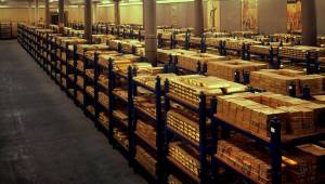 PIC FROM CATERS NEWS - (Pictured the Vault) We might be be in financial woes but dont worry theres still a few pence in the bank, inside the vault of the Bank of England which holds £156 BILLION in GOLD. As bankers are dis-honoured and Europe teeters on the brink of financial meltdown its still nice to see we have a little to fall back on. Deep underground the nations financial heart these piles upon piles of 28lb 24-carat gold bars make for reassuring viewing. Stacked on shelves like some scene from the end of an Indian Jones film the glittering nest egg is kept safe in a massive underground vault. In this image alone there are around around 15,000 bars around 210 tonnes of pure gold, with a value of around £3 billion. SEE CATERS COPY.